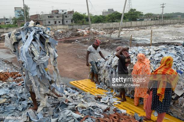 Bangladeshi labourers unload tannery waste at an export processing zone in Savar on September 2 2019