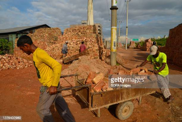 Bangladeshi labourers work at a brick-field in Dhaka. The high chimneys along the rivers, in the countryside, surrounding the Dhaka cities, pouring...