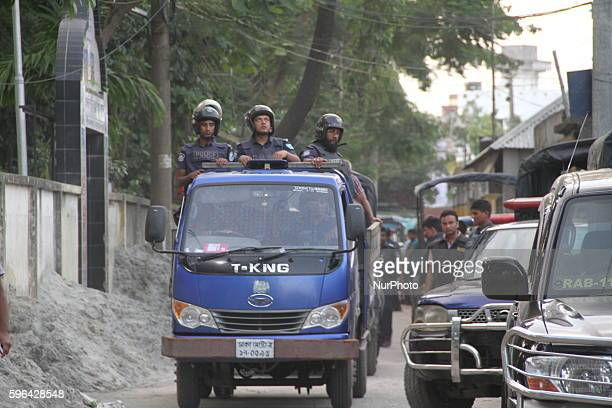 Bangladeshi law enforcers escort the bodies of three suspected militants following a gunfight at a militant hideout in Narayanganj outskirts of Dhaka...