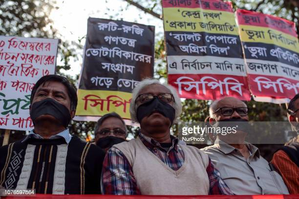 Bangladeshi leftwing activists organized by the Communist Party of Bangladesh wear black cloth over their mouths at a protest against the allegedly...