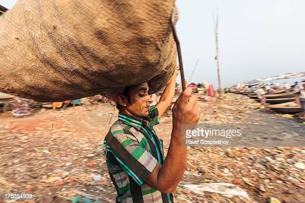 Bangladeshi man carrying heavy stuff on his head, Sadarghat Boat Terminal, Dhaka, Bangladesh, Indian Sub-Continent, Asia Sadarghat Port the Dhaka...