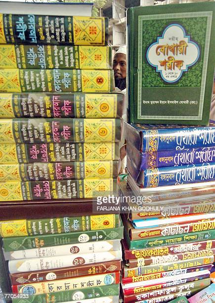 A Bangladeshi man looks at Islamic books in a stall at the Islamic book fair in Dhaka 27 September 2007 organized to mark the holy month of Ramadan...