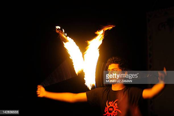 A Bangladeshi man performs a fire dance on the day of the Chaitra Sangkranti in Dhaka on April 13 2012 Chaitra Sankranti is an ageold festival of...