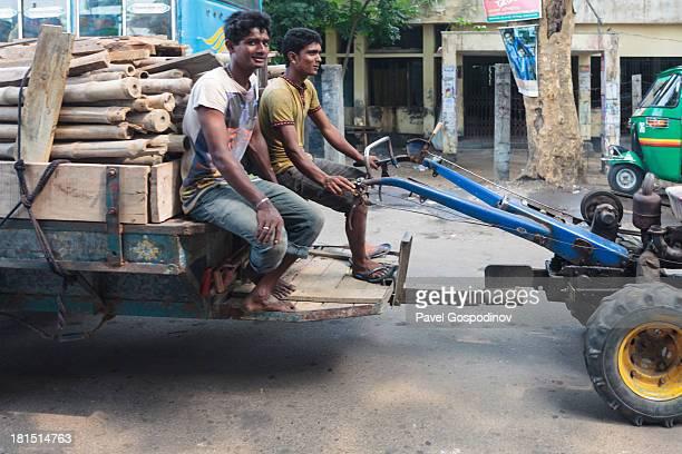 Bangladeshi man riding very weirdly designed auto-rickshaw, Ghor Dhor Basar village, Munshigong Division, Dhaka District, Bangladesh, Indian...