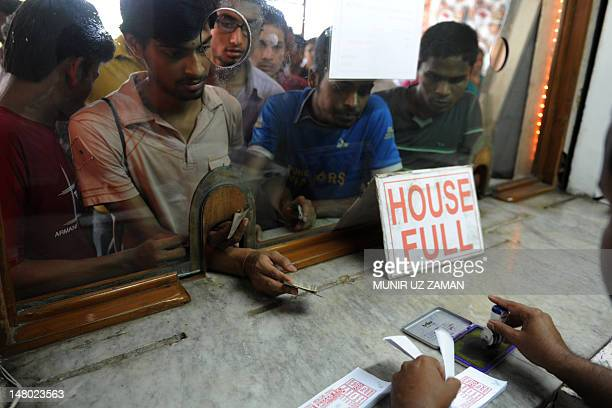 Bangladeshi men buy tickets at a movie theatre in Dhaka on July 6 2012 A film about a love affair between a transgender person and a Hindu boy has...