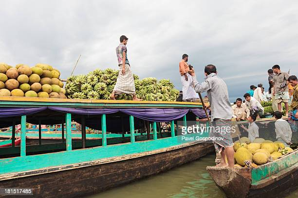 Bangladeshi men selling bannanas, jackfruit and other vegetables and fruits at Tabalcheri floating market on Kaptai Lake, Rangamati, Chittagong...
