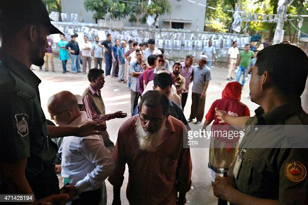 Bangladeshi men wait in a queue to cast their vote during the mayoral elections in Dhaka on April 28 2015 Bangladesh's main opposition party pulled...