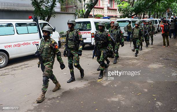 Bangladeshi military commandos walk away from an upscale restaurant after a bloody siege ended in Dhaka on July 2 2016 Heavily armed militants...