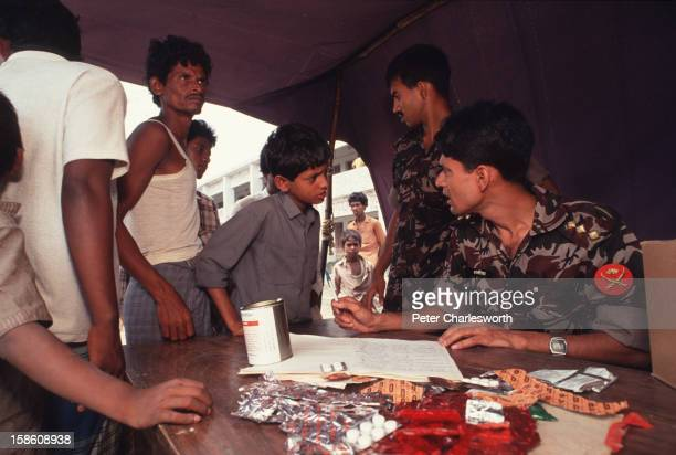 Bangladeshi military medics set up an emergency clinic where they attempt to offer medical relief to those that have survived one of the biggest...