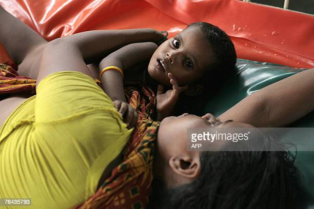 A Bangladeshi mother and child suffering from severe diarrhoea rest on a bed in The International Centre for Diarrhoeal Diseases hospital in Dhaka 31...