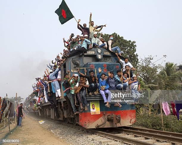 Bangladeshi Muslim devotees climb on a train to take part in Akheri Munajat or final prayers at the Biswa Ijtema or World Muslim Congregation at...