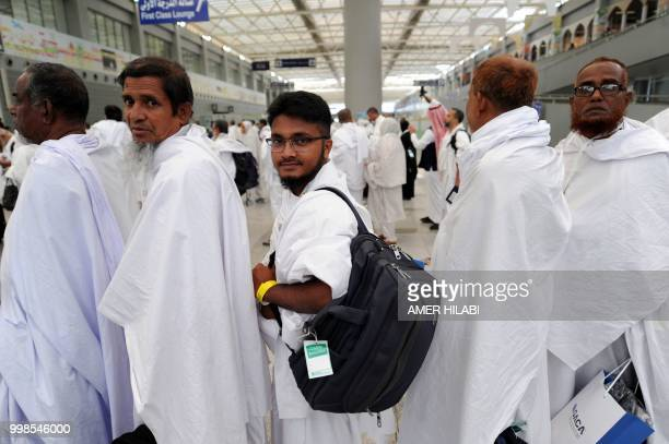 Bangladeshi Muslim pilgrims arrive at Jeddah airport on July 14 prior to the start of the annual Hajj pilgrimage in the holy city of Mecca The Hajj...