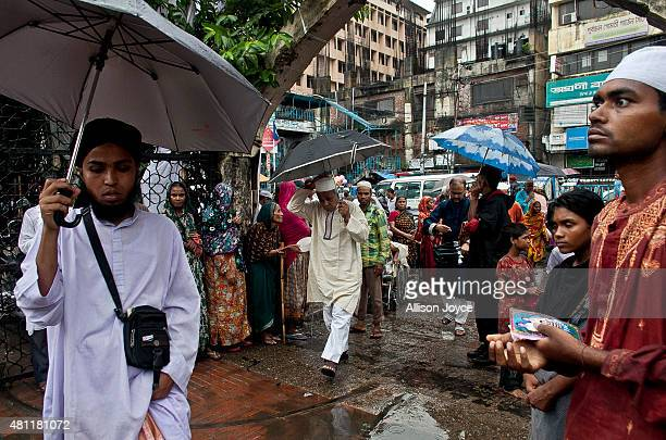 Bangladeshi Muslims arrive to pray at Baitul Mukarram the National Mosque on Eid AlFitr July 18 2015 in Dhaka Bangladesh Muslims around the world are...