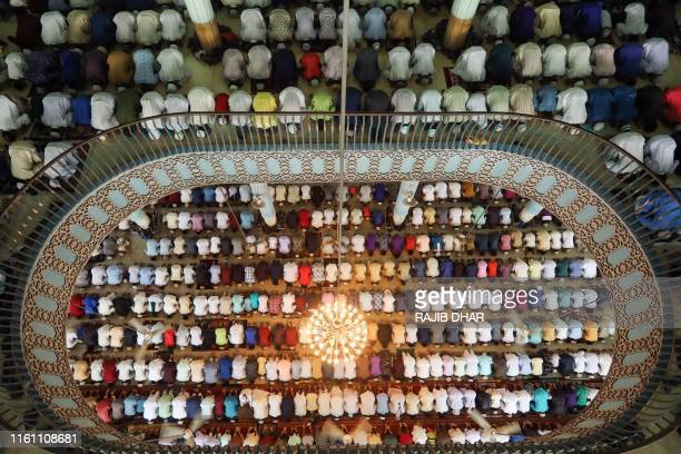TOPSHOT Bangladeshi Muslims attend Eid alAdha prayers at Baitul Mukarram National Mosque in Dhaka on August 12 2019 Muslims across the world...