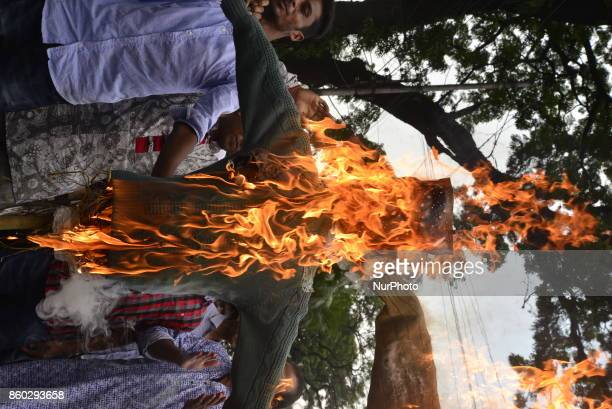 Bangladeshi Muslims burn Aung San Suu Kyis coffin and Myanmar national flag to protest against Rohgingya Muslims killing in Rakhine states in Dhaka...