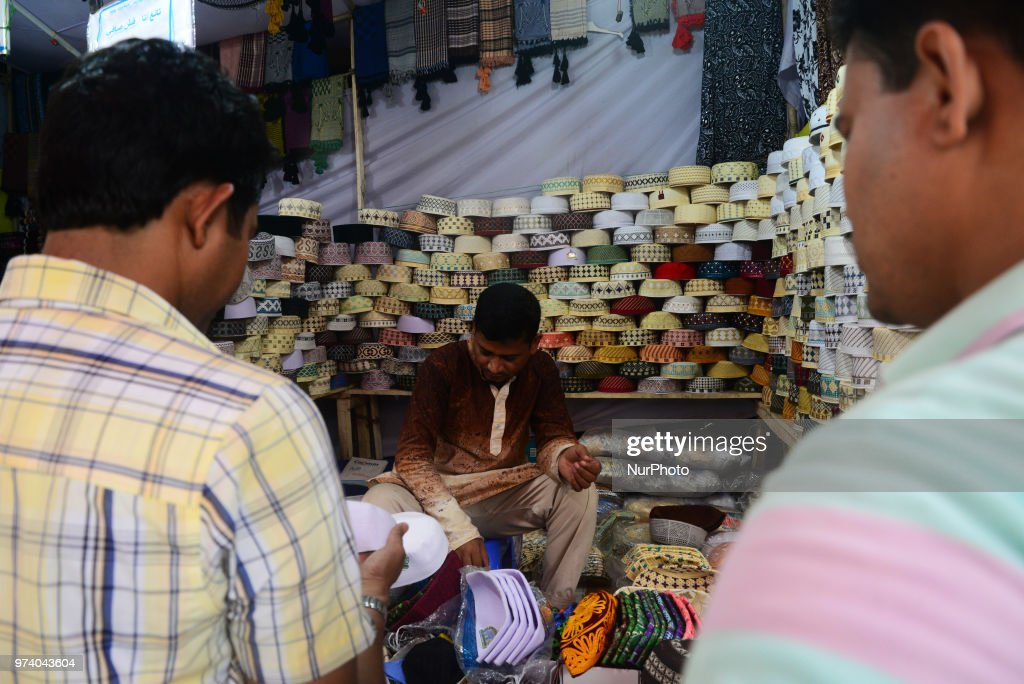 Bangladeshi Muslims buy Islamic cap for prayer ahead of Eid al-Fitr festival, during the holy month of Ramadan in Dhaka, Bangladesh, on June 13, 2018. Muslims observe Eid-al-Fitr which marks the end of Ramadan. People prepare feasts, wear new clothes and apply Henna to celebrate the festival.