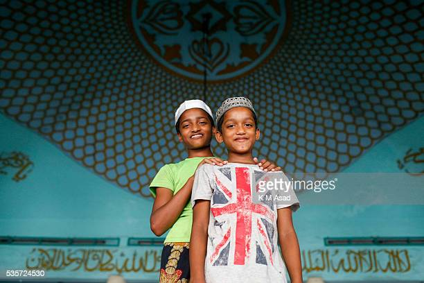Bangladeshi Muslims children come to join a special night prayer at the National Mosque of Bangladesh to mark ShabeBarat or 'night of forgiveness' in...