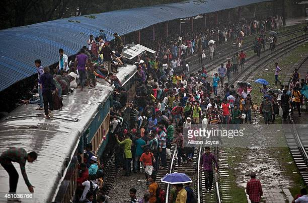Bangladeshi Muslims crowd onto a train during a downpour to head home to their respective villages ahead of Eid AlFitr July 17 2015 in Dhaka...