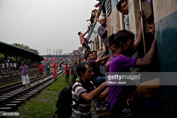 Bangladeshi Muslims crowd onto a train to head home to their respective villages ahead of Eid AlFitr July 17 2015 in Dhaka Bangladesh The Eid AlFitr...