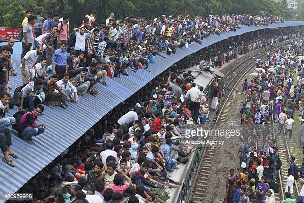 Bangladeshi Muslims make space for themselves inside the overcrowded train to head home ahead of Eid alFitr as others wait at a railway station in...
