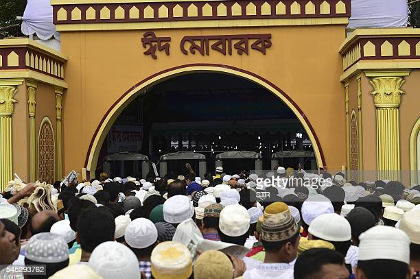 Bangladeshi Muslims offer Eid alFitr prayers in Dhaka on July 7 2016 Suspected Islamists carried out a new deadly attack at a huge prayer gathering...