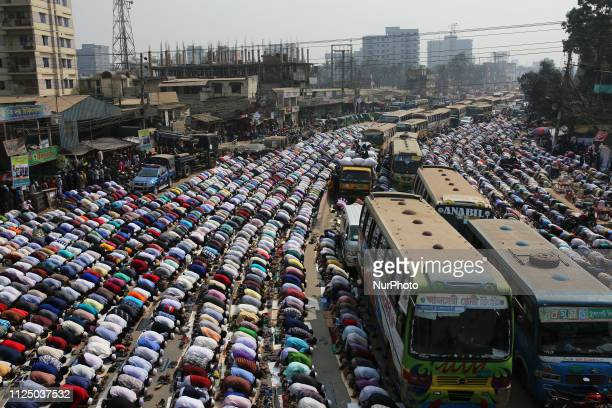 Bangladeshi Muslims offer Friday prayer on a road during the world's second largest Muslims congregation also known as Biswa Ijtema at Tongi near...