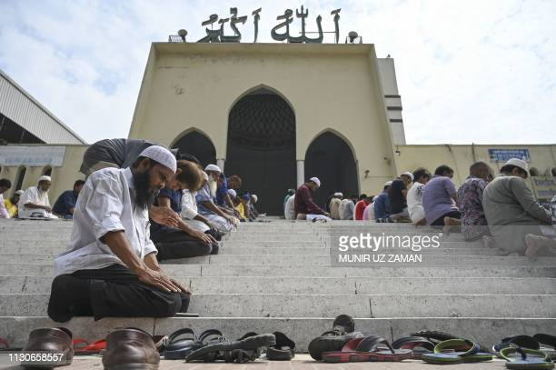 Bangladeshi Muslims offer Friday prayers after protesting against attacks on two mosques in New Zealand in Dhaka on March 15 2019 Attacks on two...
