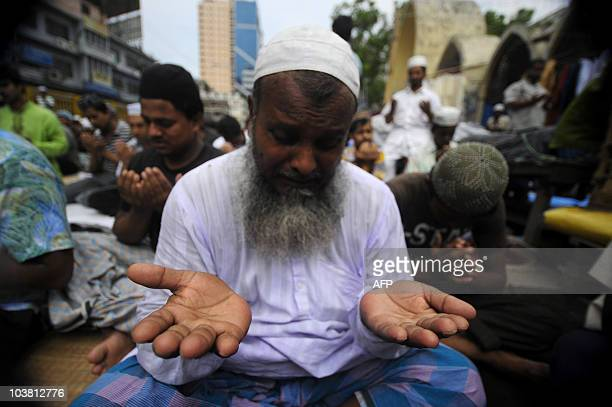 Bangladeshi Muslims offer JummatUlVida prayers on the last Friday of Ramadan outside the National Mosque of Bangladesh Baitul Mukarram in Dhaka on...