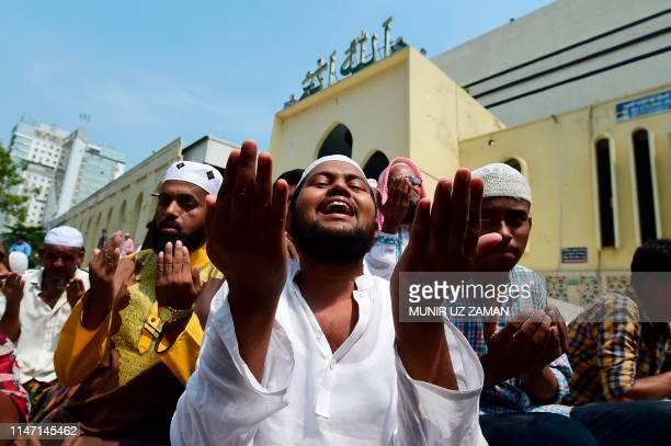 Bangladeshi Muslims offer JummatUlVida prayers on the last Friday of the holy fasting month of Ramadan outside the National Mosque of Bangladesh...