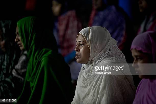Bangladeshi Muslims pray at Baitul Mukarram the National Mosque on Eid AlFitr July 18 2015 in Dhaka Bangladesh Muslims around the world are...