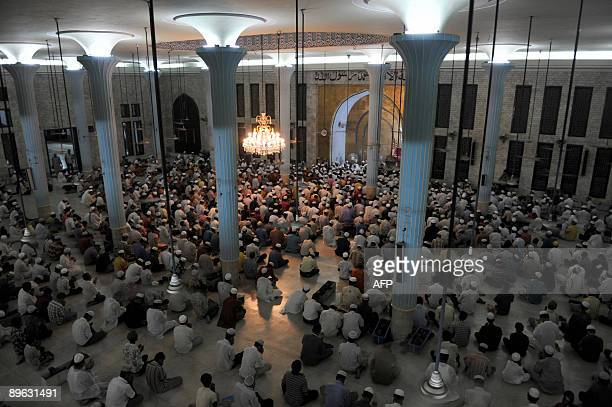 Bangladeshi Muslims pray during a special night prayer at the National Mosque of Bangladesh to mark ShabeBarat or 'night of forgiveness' in Dhaka on...
