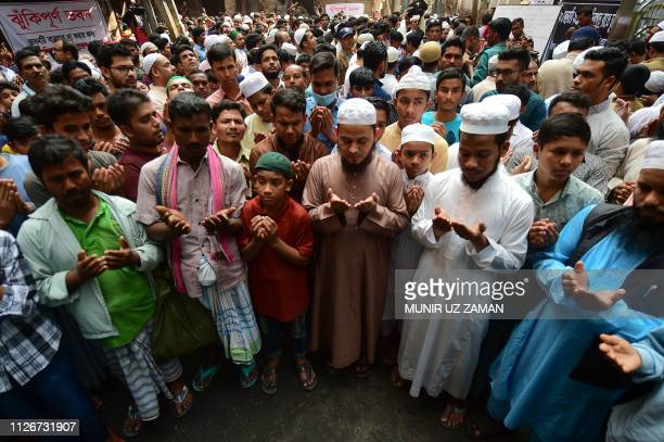 Bangladeshi Muslims pray for the victims of a fire in Dhaka Bangladesh's capital city on February 22 2019 Funerals started on February 22 for victims...