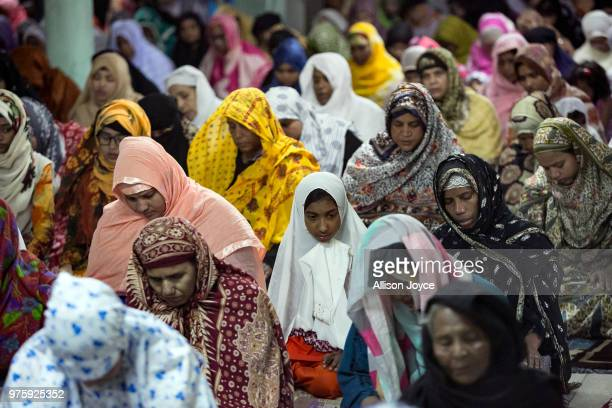 Bangladeshi Muslims pray on Eid alFitr June 16 2018 in Dhaka Bangladesh Muslims around the world celebrate Eid alFitr with their families with...
