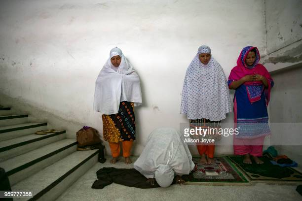 Bangladeshi Muslims pray on the first day of Ramadan on May 18 2018 in Dhaka Bangladesh Bangladeshis began observing Ramadan on Friday as millions of...