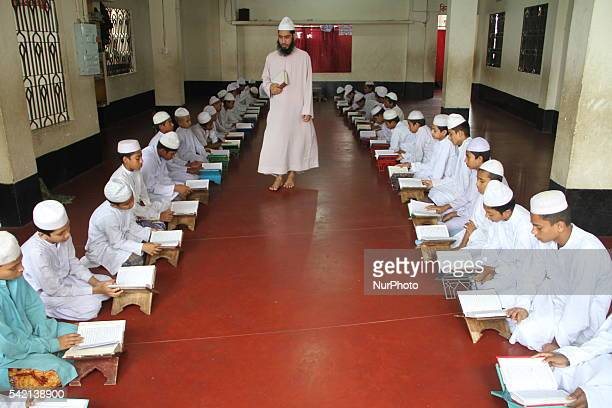 Bangladeshi Muslims read Quran at a Madrasa during the Islamic holy month of Ramadan in Dhaka Bangladesh on June 22 2016 Muslims around the world are...