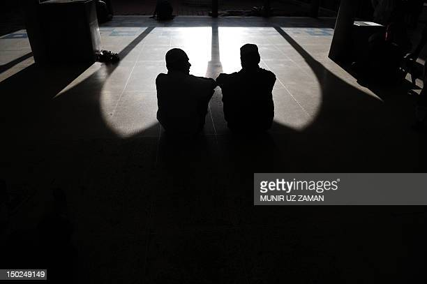 Bangladeshi Muslims rest at the National Mosque of Bangladesh Baitul Mukarram during the holy fasting month of Ramadan in Dhaka on August 13 2012...