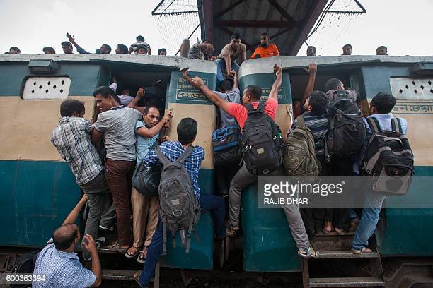 Bangladeshi Muslims scramble to reach the roof of an overcrowded train as they try to get home to their respective villages to be with their families...