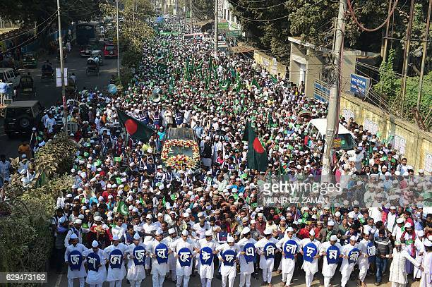 Bangladeshi Muslims take part in a rally to mark EideMiladunNabi the birthday of the Prophet Mohammad in Dhaka on December 13 2016 / AFP / MUNIR UZ...