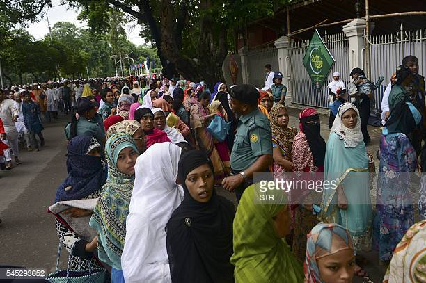 Bangladeshi Muslims wait in a queue for a security check prior to Eid alFitr prayers in Dhaka on July 7 2016 Suspected Islamists carried out a new...