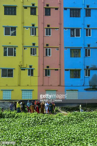 Bangladeshi onlookers gather at the site of the Rana Plaza building collapse on the third anniversary of the disaster in Savar, on the outskirts of...