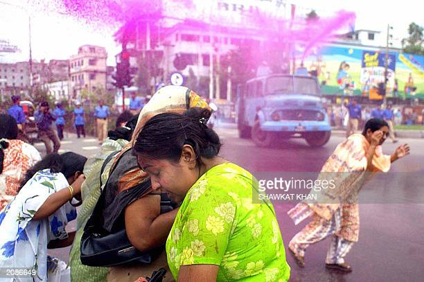 Bangladeshi opposition Awami League activists run away from a police water canon during demonstration in Dhaka 12 June 2003 At least 20 people were...