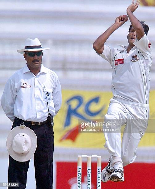 Bangladeshi pacer Shahadat Hossain delivers the ball to Sri Lankan batsman Kumar Sangakkara during the second day of the second Test match between...