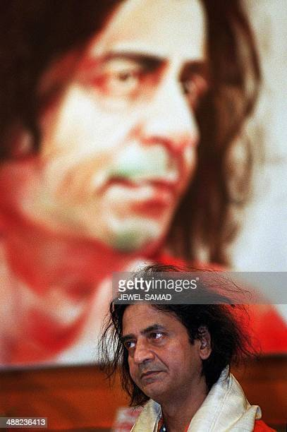 Bangladeshi Parisbased artist Shahabuddin Ahmed listens to wishes on his 50th birthday 11 September 2000 in a major auditorium in Dhaka He was almost...