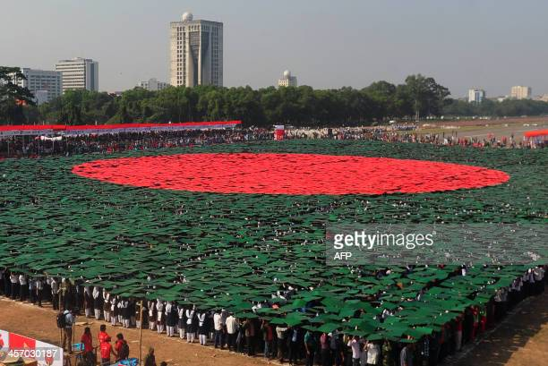 Bangladeshi participants form the worlds largest human national flag to mark the country's Victory Day in Dhaka on December 16 2013 A total of 27117...