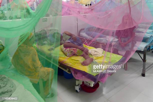 Bangladeshi patients suffering from dengue fever receive treatment at the Shaheed Suhrawardy Medical College and Hospital in Dhaka on September 3,...