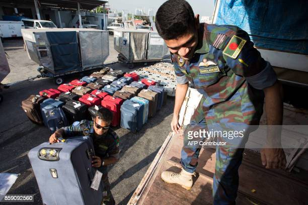 UN Bangladeshi peacekeepers of the United Nations Stabilization Mission in Haiti prepare to leave Haiti at Toussaint Louverture International Airport...