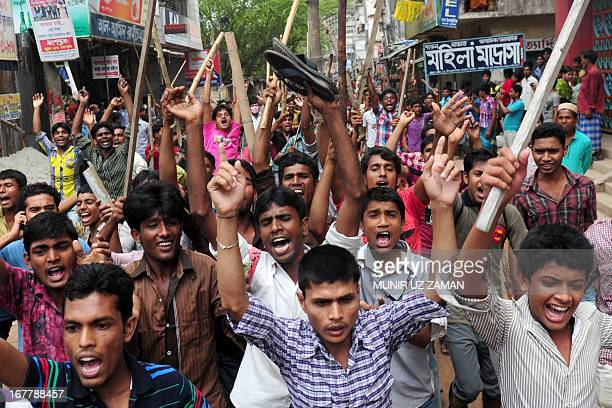 Bangladeshi people and garments workers march in the street demanding the death sentence for owner of Rana Plaza Sohel Rana following the eightstorey...