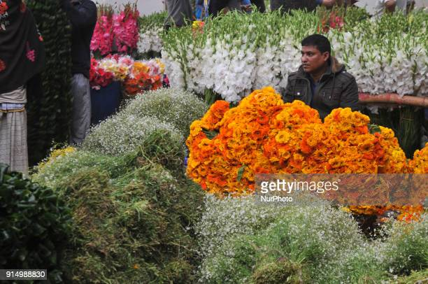 Bangladeshi people are busy with the trade of flower at Shahbag in Dhaka on Monday 05 February 2018 Thousands of people come this market to buy...