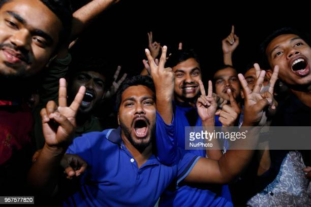 Bangladeshi people are celebrating in Dhaka on May 12 2018 as the country's first communications satellite the Bangabandhu1 blasted off from the...