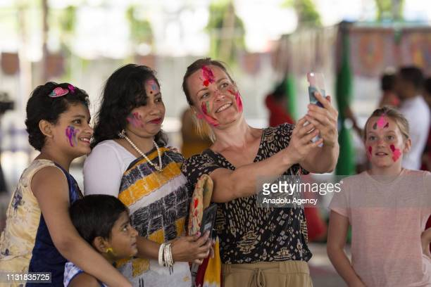 Bangladeshi people celebrate the Holi Fest festival of colors in Dhaka Bangladesh on March 21 2019 Holi is a Hindu spring festival celebrated in...